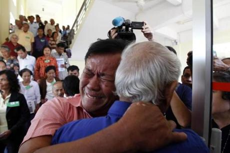 Khmer Rouge survivors Soum Rithy (left) and Chum Mey embraced after the verdicts were announced at the UN-backed war crimes tribunal in Phnom Penh, Cambodia.